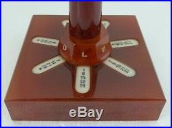 Ancien calendrier perpetuel bakelite ambre forme phare art déco TBE