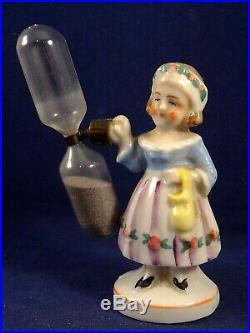 Ancien sablier jeune fille à l'ombrelle porcelaine Germany Numéroté 1930