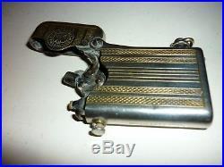 Briquet Thorens ancien style art déco en métal argenté à restaurer